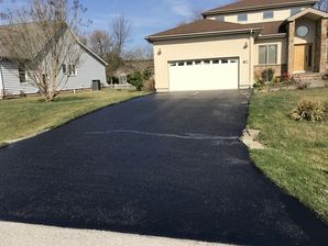 Before & After Driveway Crack Filling and Sealcoating in  Rehobeth Beach, DE (4)