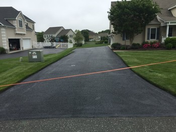 Before & After Seal Coating Driveway Felton, DE